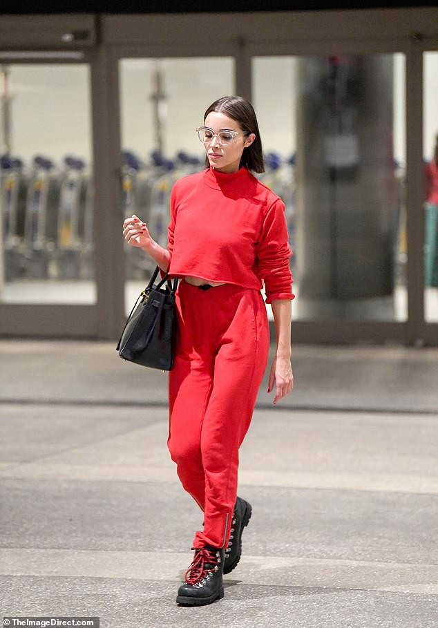 Alert! Olivia Culpo created her own mini catwalk when she landed stateside at Los Angeles International Airport on Wednesday morning