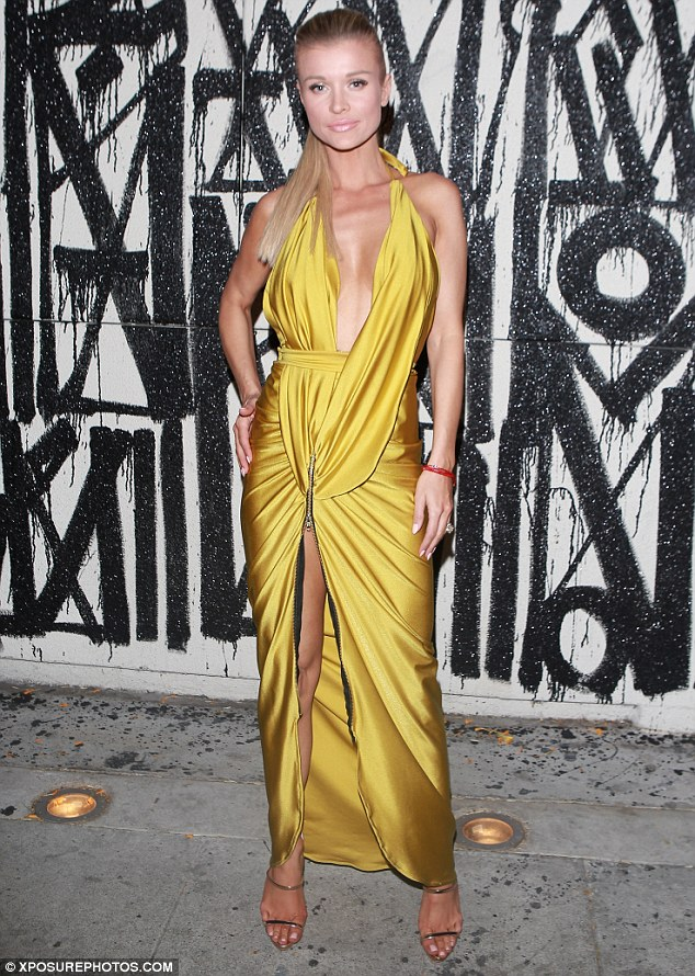 Go-to look: The former Real Housewives of Miami star took a familiar play out of her own style book, dressing in a racy evening ensemble