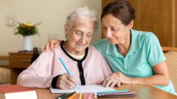 A carer with an elderly person