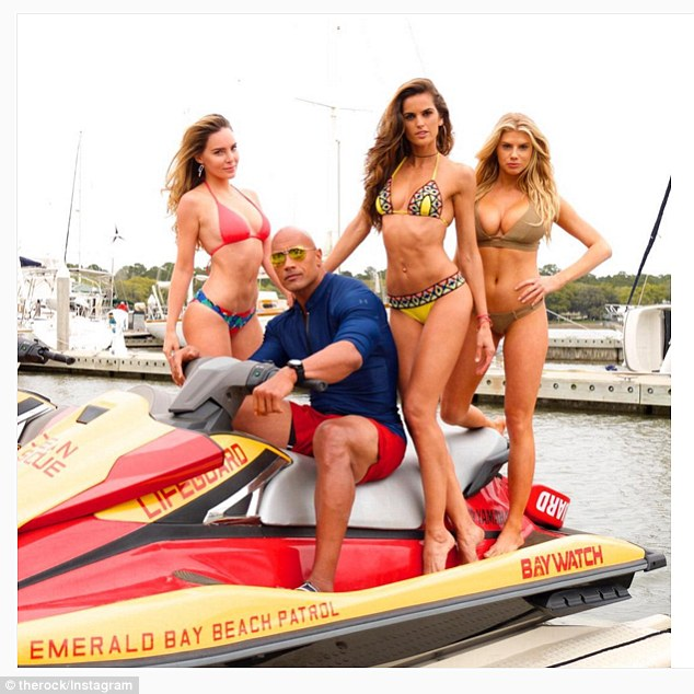 Acting job: On Monday, the model shared a photo on the set of Baywatch.In the snap, Charlotte is seen posing atop a jet ski next to Brazilian beauty Izabel Goulart, 31, Mexican stunner Belinda Peregrin, 26, and The Rock, 43