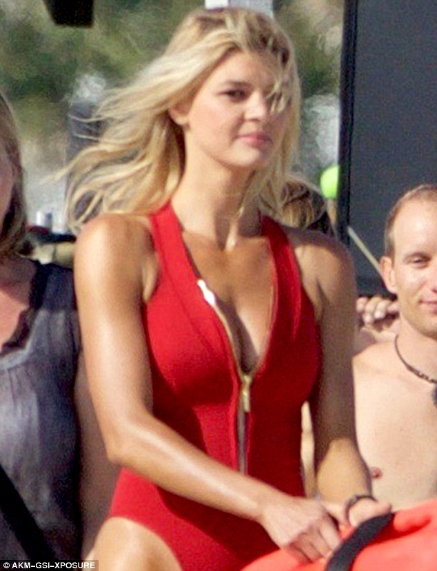 Updated version: The actress and model displayed the modern take on the classic red swimsuit, featuring its new zippered front verses the classic scoop neck