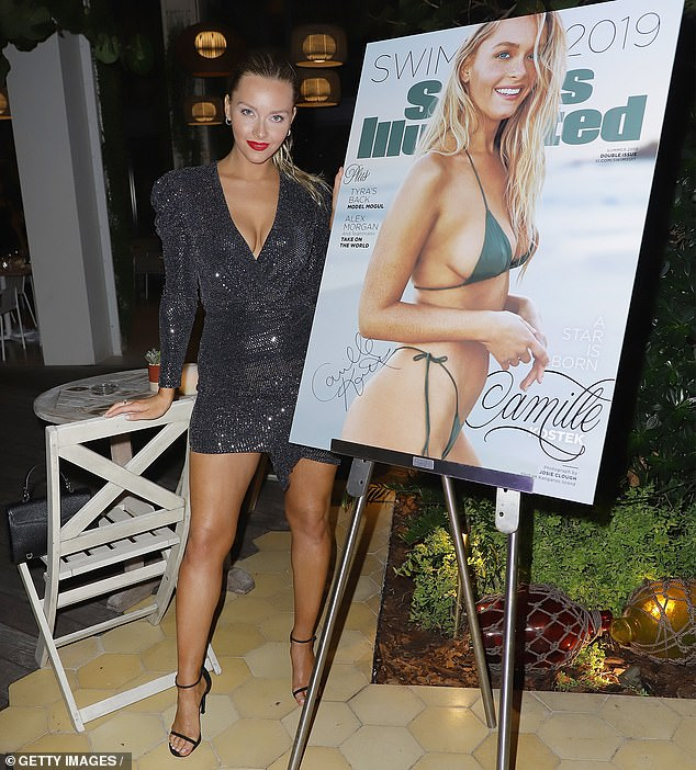 Big night: The short look highlighted her long, tanned legs, and she added in a pair of tall black open-toe heels