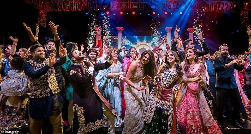 All together: Priyanka and Nick celebrated with a party called a Sangeet where she danced to her own Hindi film songs, and where her movie star cousin Parineeti Chopra joined her friends to reenact the story of the Priyanka-Nick romance