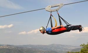 Riding the zip wire between Castelmezzano and Pietrapertosa.