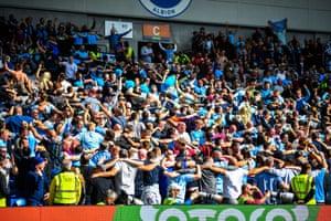City fans do the 'Poznan'.