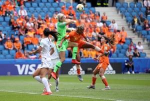 Erin Nayler of New Zealand clears the ball under pressure from Shanice Van De Sanden of the Netherlands.
