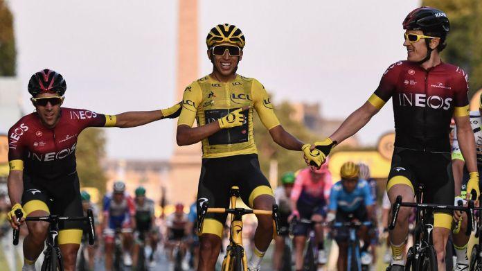 Team Ineos riders Jonathan Castroviejo (left) and Geraint Thomas (right) congratulate Egan Bernal on his Tour de France win