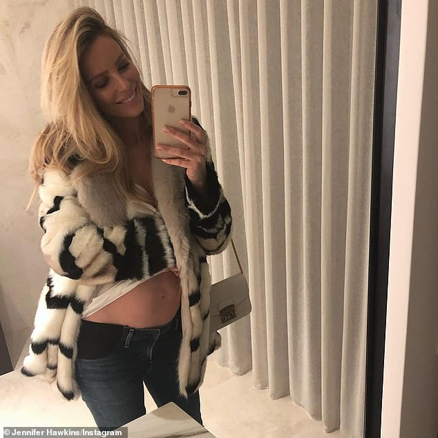 Oh baby: Supermodel Jennifer announced in May that she's expecting her first child with her husband of five years, Jake Wall, just weeks before Edwina's announcement. Pictured at four months pregnant