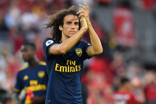 Matteo Guendouzi applauds Arsenal supporters after the game against Liverpool