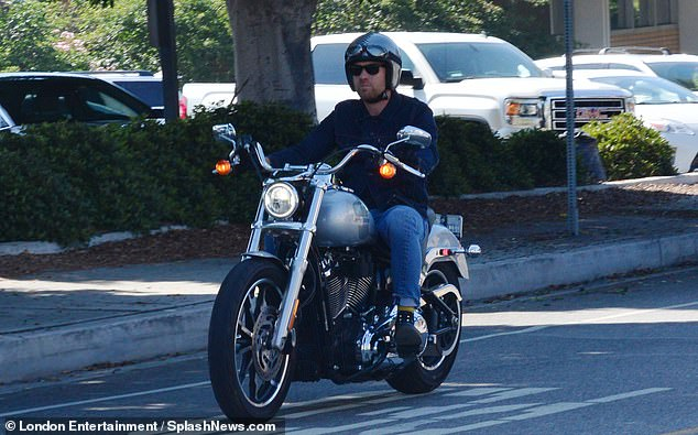 Cool:Ewan McGregor looked effortlessly cool as he zoomed around Brentwood, California on his motorbike on Wednesday