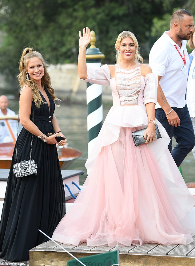 Stunning: Hofit Golan made sure she remained in the spotlight as she arrived at the Venice Film Festival by boat on Saturday (pictured with Maja Malnar)