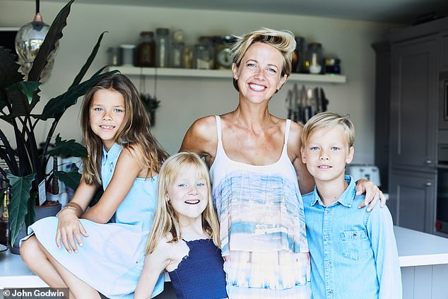 'It's better to be open': Helen Addis with daughters Belle, far left, and April, and son Archie