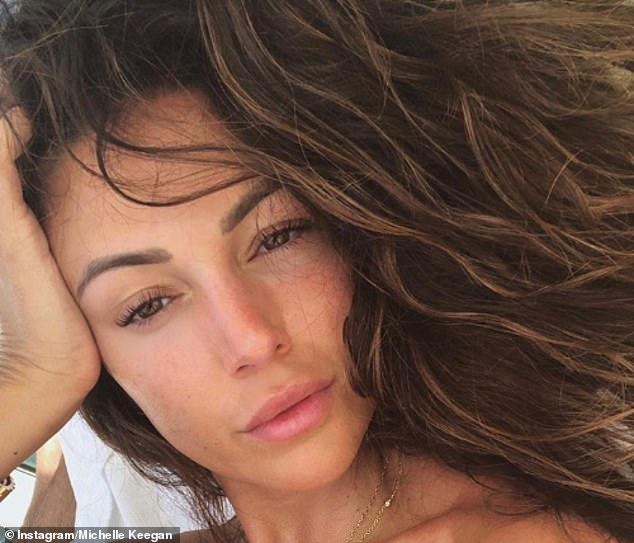 Natural beauty: Michelle Keegan looked stunning as she shared a radiant snap from her holiday in Ibiza on Wednesday