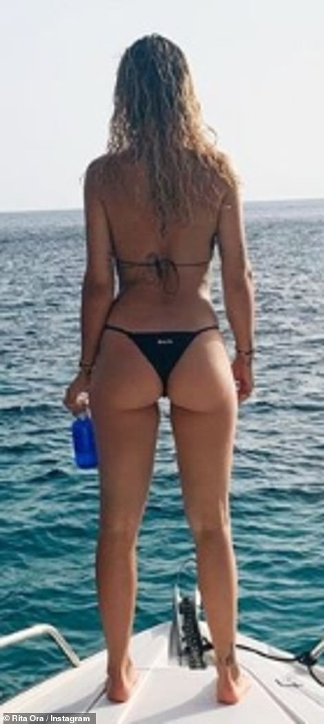 Holiday: Prior to storming the stage, Rita bid farewell to Ibiza as she displayed her athletic physique in a stunning bikini snap on Saturday