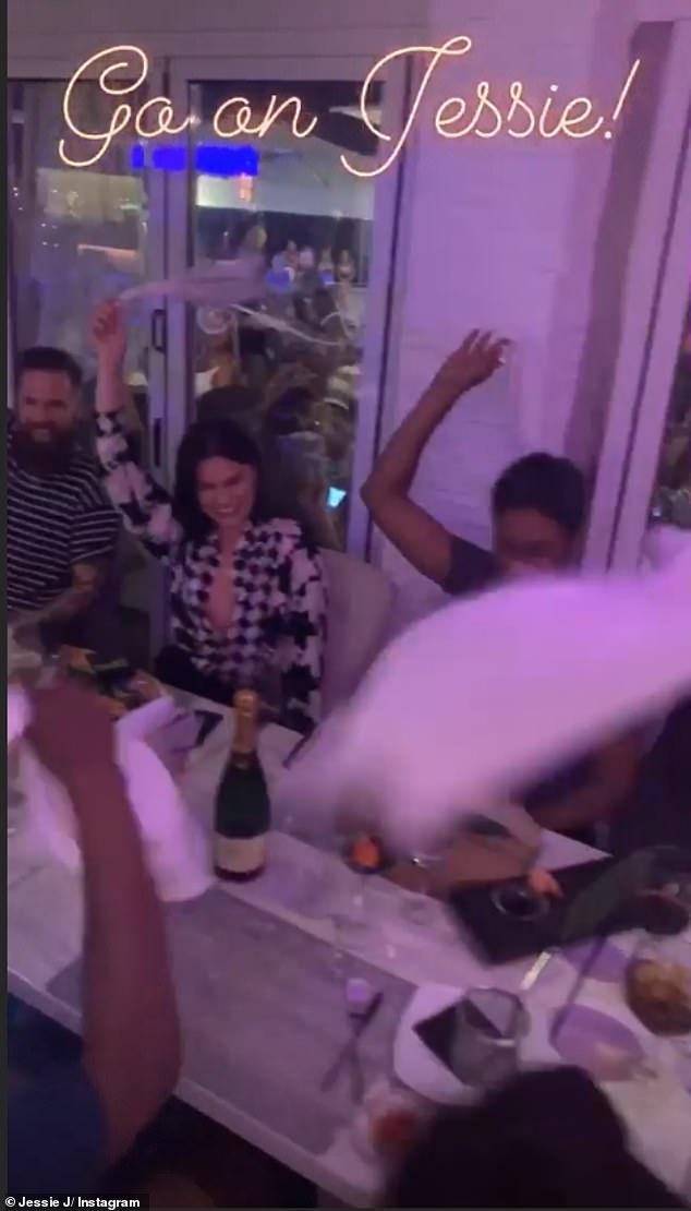 Having a blast: Jessie and her entourage waved napkins around their head to celebrate Arg's grand entrance