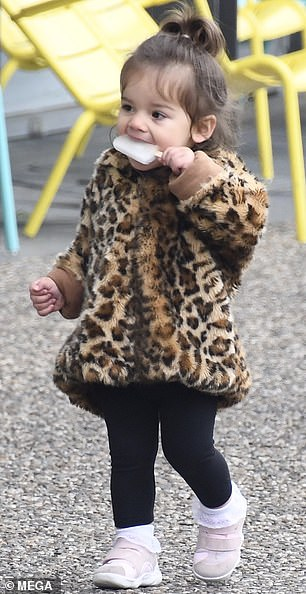 Yum! Adorable little Gigi enjoyed her ice block as walked with her mother and older sister Aleeia