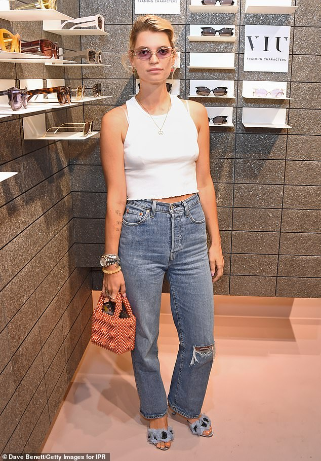 Unusual:The daughter of singer Bob Geldof teamed her laid-back look with a red spotted handbag and pale blue furry sandals
