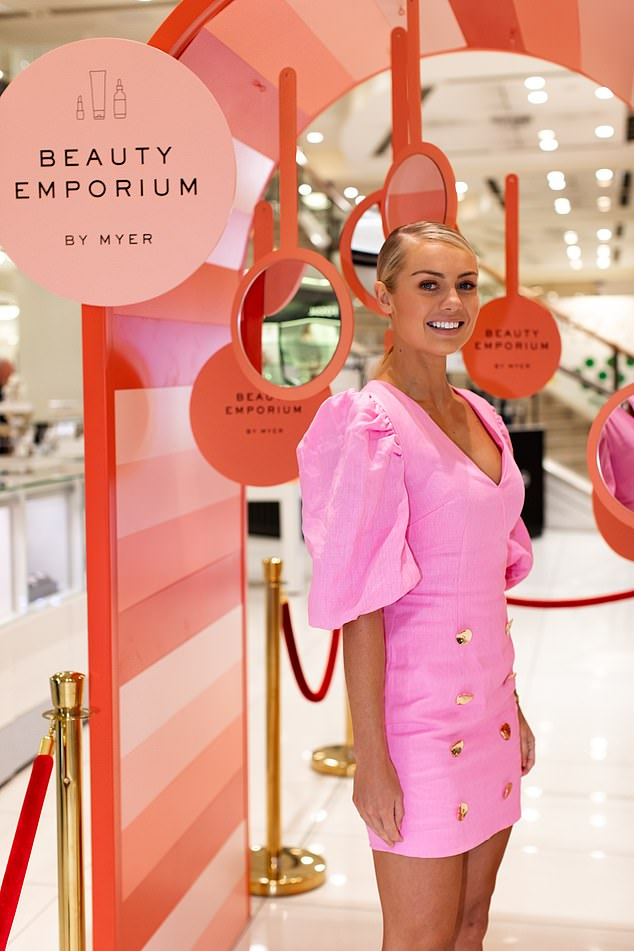 Gorgeous! Despite her admitted skin problems, Elyse look absolutely flawless in a bright pink mini dress at the opening of Myer's Beauty Emporium in Sydney on Friday