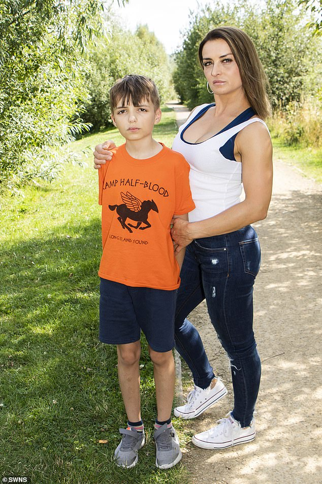 The manufacturers of her implants, Allergan, recalled their product worldwide last month due to alleged links to cancer. She is pictured with her son Daniel Lucas, 12