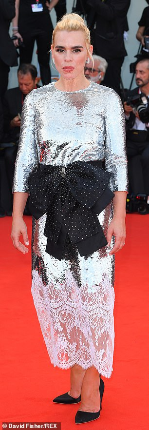 Glam: The bottom of the gown was embellished with white lace and she completed the ensemble with killer black heels
