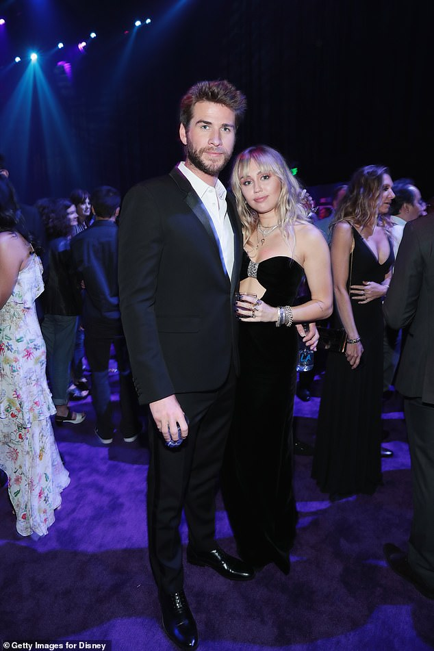 Happier times:According to People, It has been claimed Miley is upset with the 29-year-old actor's decision, as although she's 'doing well', it's 'hard' for her to accept her relationship is over; pictured together April 22 at the premiere of Avengers: Endgame in Los Angeles