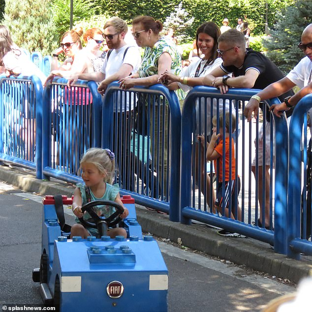 Baby driver: Their children were having the best day as little Sofia was snapped zooming around in a car on a children's race track as her parents watched on
