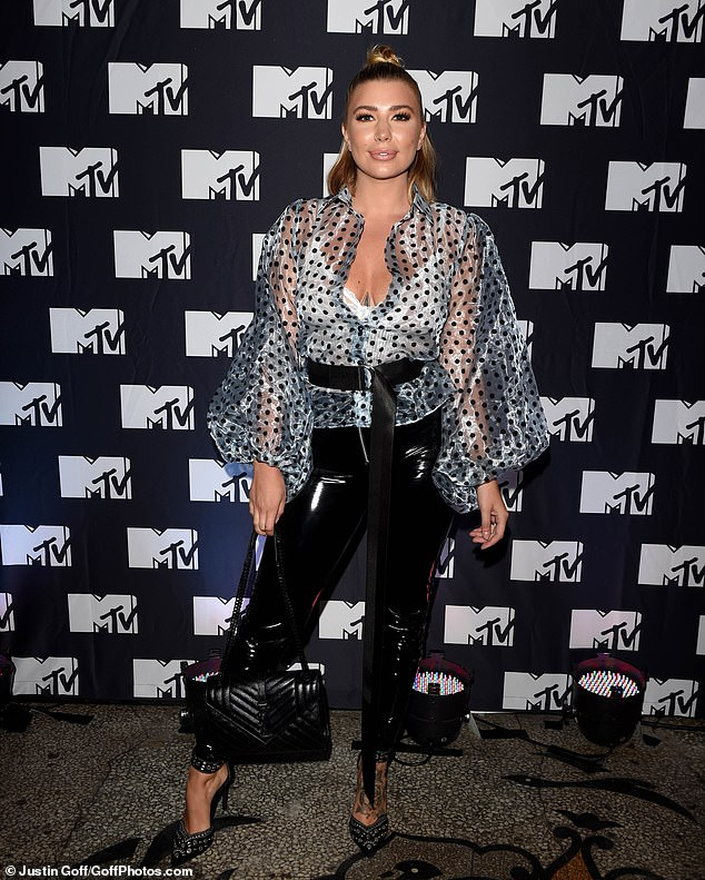 The Love Island beauty, 25, certainly turned heads as she flashed her white lacy bra at Charlotte Dawson's MTV dating show launch, held at the Grand in Clapham