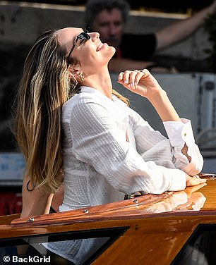 Full of joy:Candice appeared happy and relaxed as she strolled through the Italian city, before making her way onto a water taxi