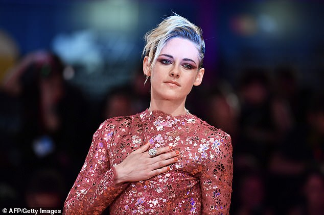 Impassioned:Kristen kept her platinum blonde tresses in a Pompadour style, and sported a dramatic smoky eye as she made her way along the red carpet