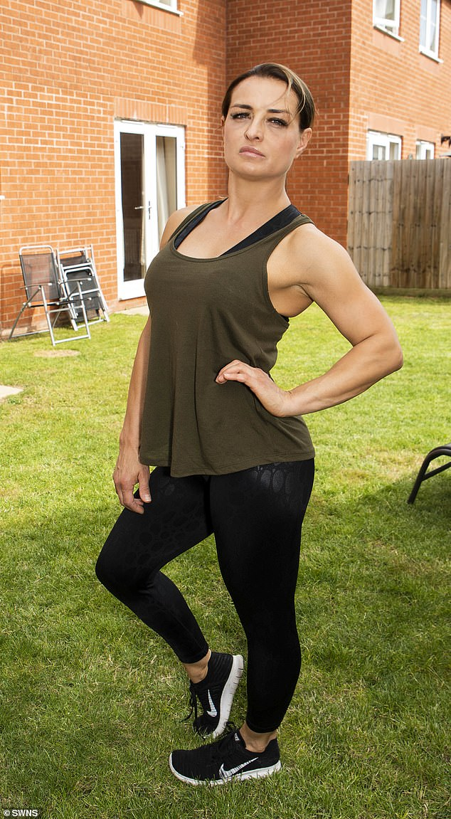 Ms Michalkova said she opted for the 'safest implants' but they had destroyed her body. She is pictured at her home inCheltenham, Gloucestershire