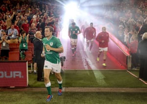 The players, including Ireland's Jack Carty (left) take to the pitch.