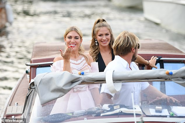 Party:Styling her blonde locks into an updo for the evening, Hofit blew a kiss as she got off the boat and made her way toward the annual festival