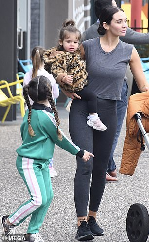 Cute! Little Aleeia appeared to take a style note from Rachael in her sporty matching green tracksuit with and sneakers