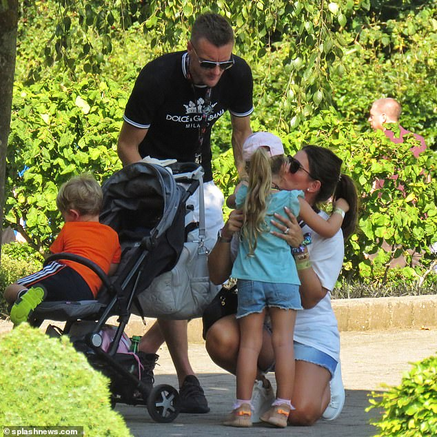 So much love: The couple doted on their children during the outing, stopping to shower them with hugs and kisses