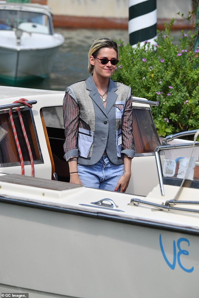 Her own style:The star teamed her cropped blazer with a pair of ripped, pale denim jeans and shiny black lace-up shoes