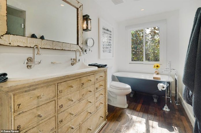 Wash up! The home also includes updated, vintage-inspired bathrooms with large vanities and clawfoot tubs