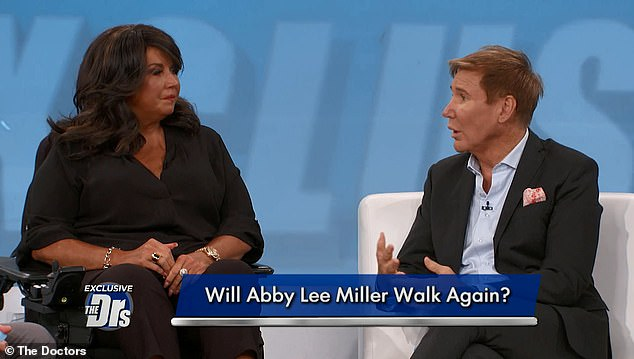 Walking again: Abby Lee Miller of Dance Moms fame has taken her first few steps in public after a long cancer battle. Here she is seen on The Doctors on Monday with her doctor, Lawrence Piro