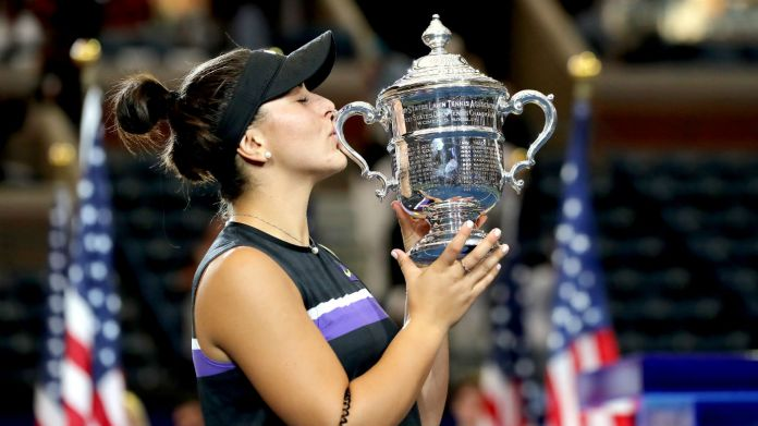 Bianca Andreescu kisses the championship trophy after her US Open win against Serena Williams