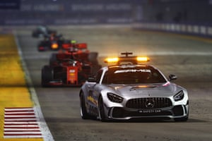 The safety car leads Vettel.