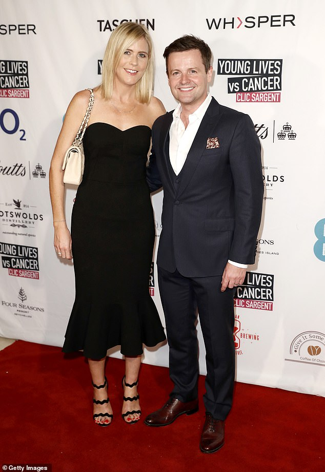 Dressed to impress: Dec cut a dapper figure in a dark, three-piece suit, while Ali stunned in a chic, little black dress
