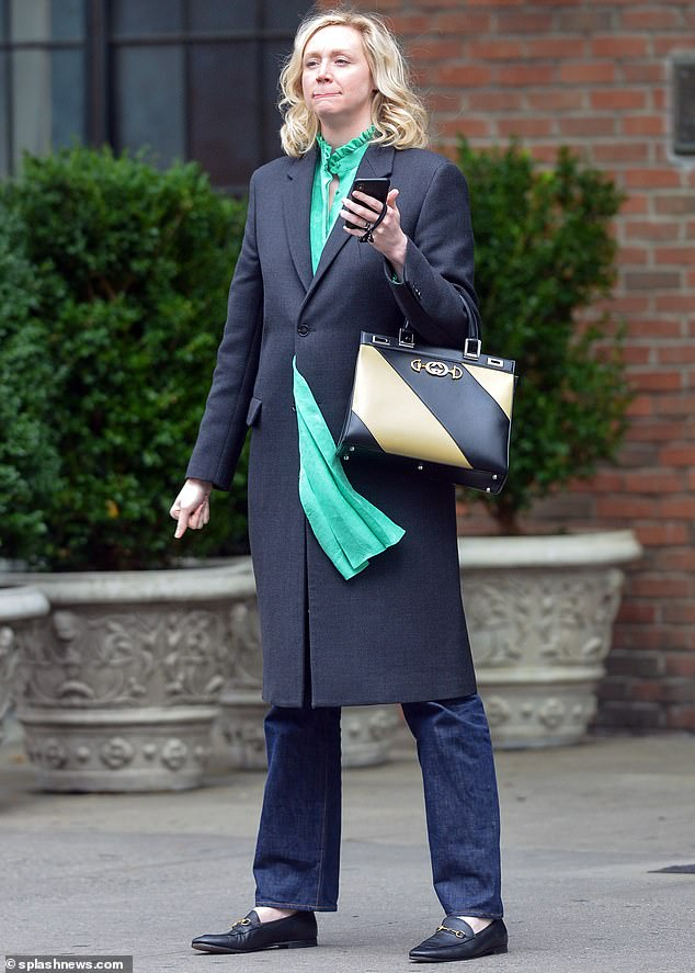Splash of color:The 40-year-old actress was spotted enjoying a stroll in Manhattan while modeling a sleek navy coat over an eye-popping sea green blouse