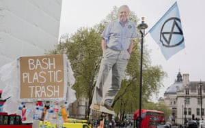 Extinction Rebellion protesters hold up an image of David Attenborough in Parliament Square in April.