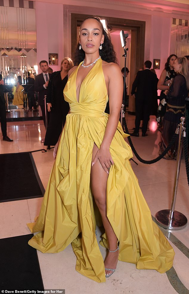 Leggy: The gown's thigh-high split also accentuated her slender pines as she headed into the awards show