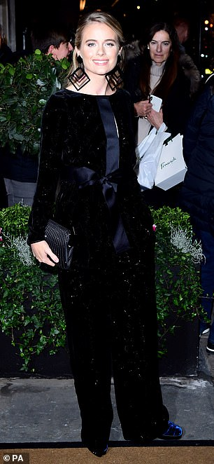 Grand arrival: Cressida finished her look with blue velvet heels and a grey clutch bag