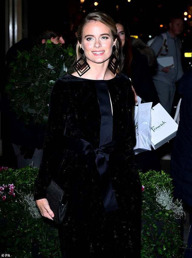 Turning heads:The ex-girlfriend of Prince Harry looked stunning in the velvet one-piece which had a delicate silver sequinned effect