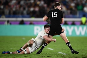 New Zealand's full back Beauden Barrett (R) is tackled by England's flanker Tom Curry