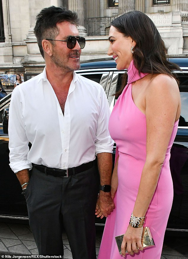 Birthday event:Simon and Lauren sent guests a cancellation on Monday, just two days before the celebration, it read: 'Dear all, I am so sorry but this dinner is cancelled/postponed' (pictured together in July)