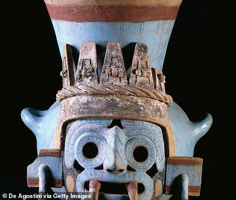 Adorned with carvings and paintings, the passageway that dates back to the 15th century is believed to have been built by Emperor Montezuma I and linked to the god of water and fertility ¿ Tlaloc (pictured is a representation)