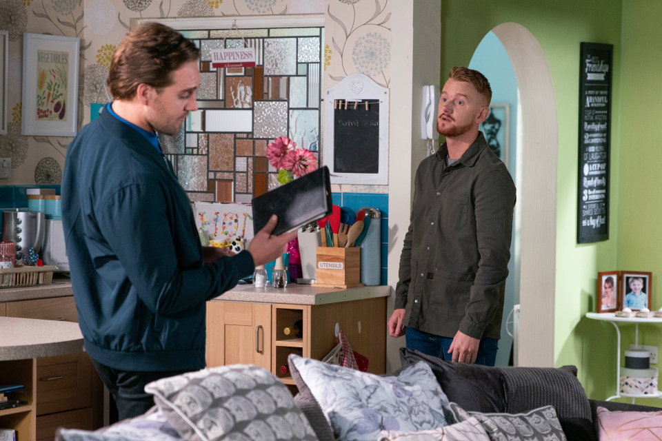 Gary appears to be reasoning with Ali who is struggling to overcome his drug addiction