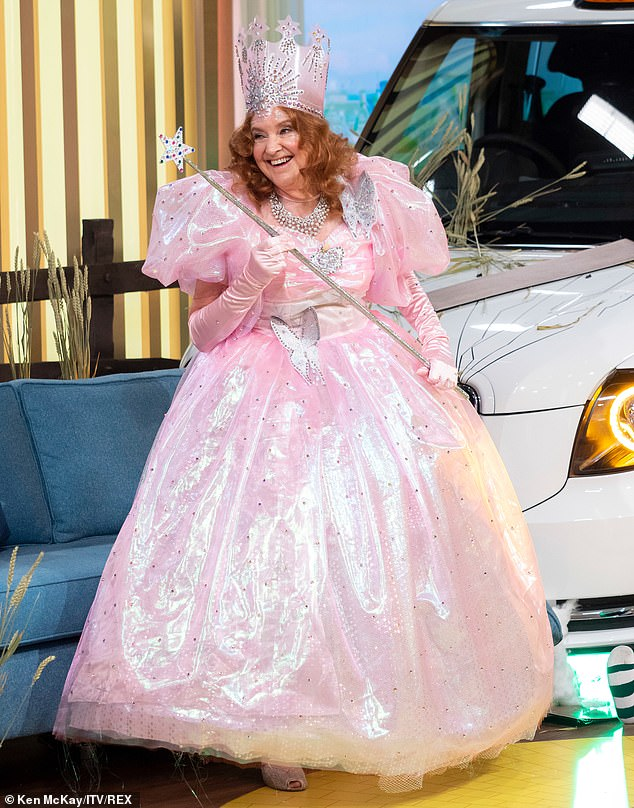 Pretty in pink! Glinda the Good Witch arrived in the form of Deidre Sanders aka Dearest Deidre